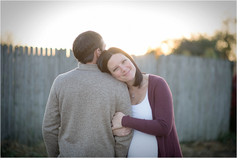 Katelyn beams in the evening glow - a perfect maternity shoot in Sycamore, IL.