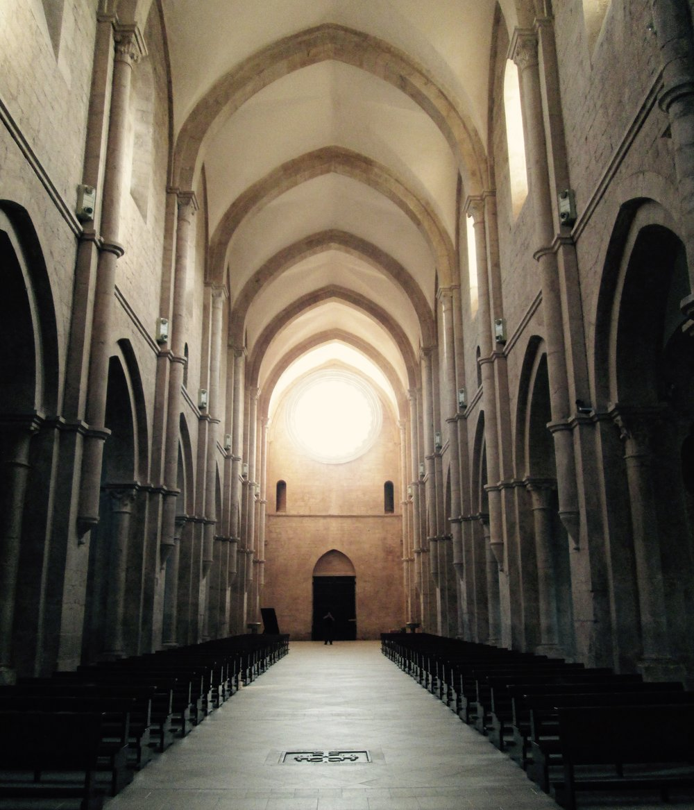 nave of fossanova church, in which st. thomas was initially buried
