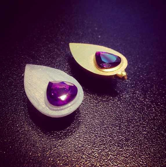 The original resin print and the first rough cast in gold, holding the pair of amethysts