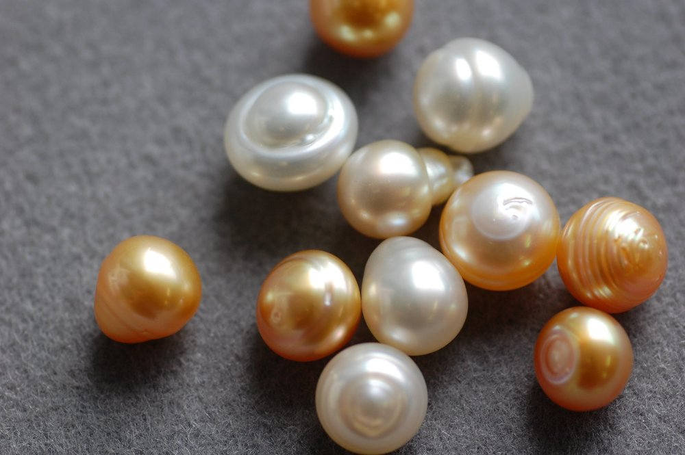 A selection of differently shaped pearls showing natural imperfections