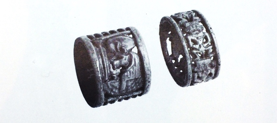 Ancient Egyptian ring on right showing interlinking imagery of the Deity Bes