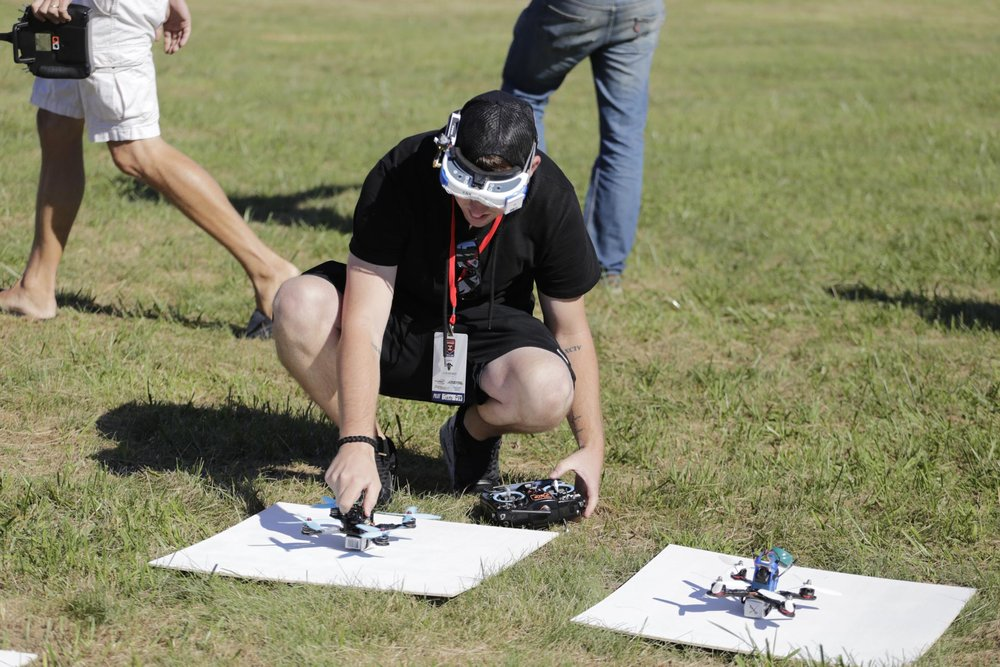Muncie, Indiana - FPV  Pilot palces his quadcopter on the start pads before a race during the 2016 MultiGP National Championship. Photo: Zephyr McIntyre