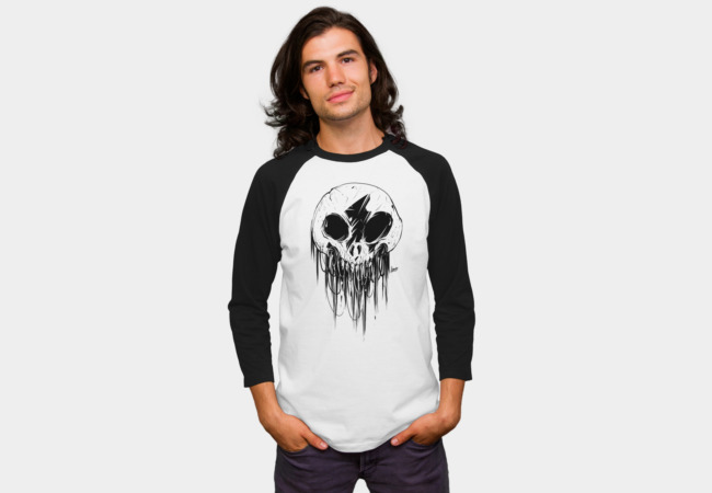 Feathered Skull Raglan Tee The feathered skull can be used to reach across dimensions into the world of Kōnazon. Just be very careful about who you summon.