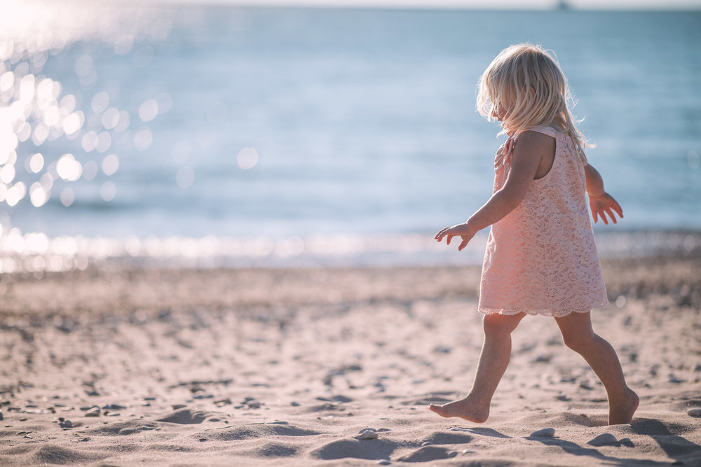 blonde-girl-walk-in-sand-at-beach.jpg