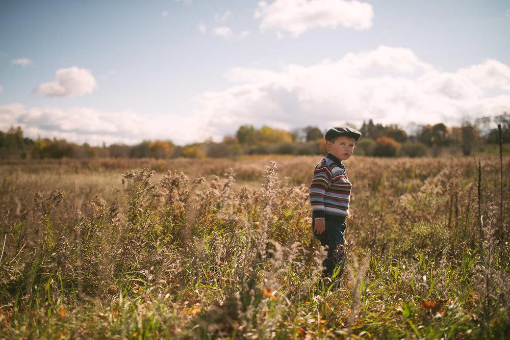 cute-boy-field-family-photographer.jpg