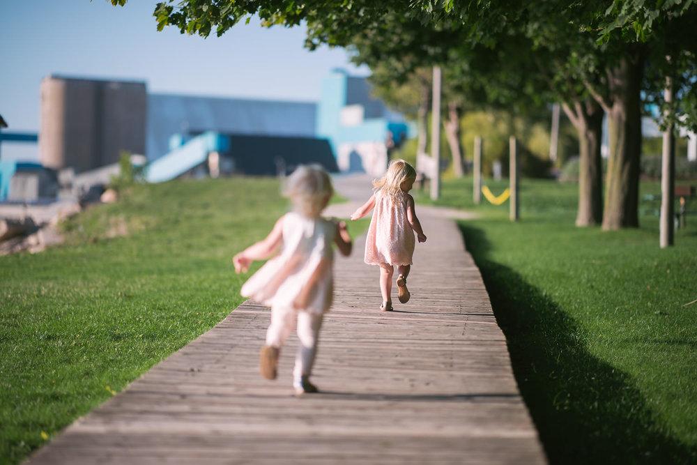 cute-sisters-run-down-boardwalk.jpg