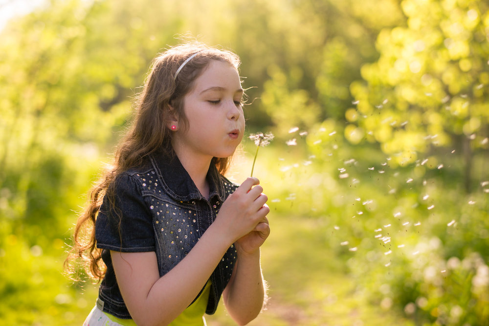 girl-blows-dandelion.jpg