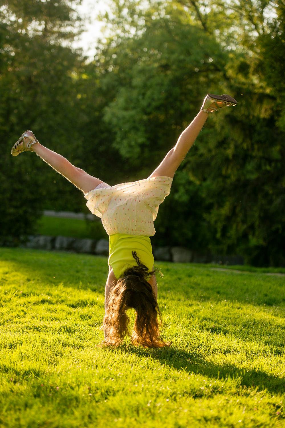 girl-does-cartwheel-sunset.jpg
