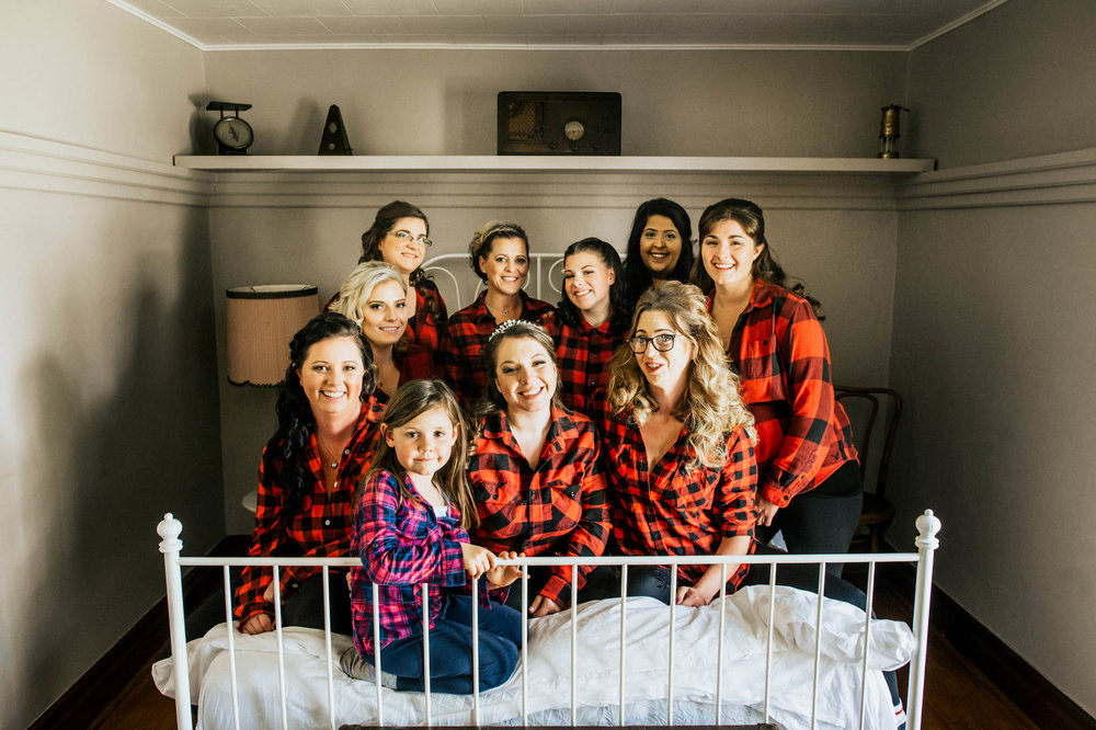 bridal-party-piles-on-bed-at-the-inn-cranberry-creek-001.jpg