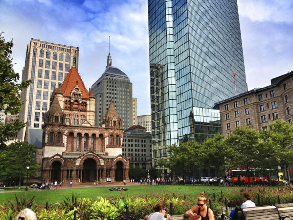 The Hancock Tower does its best to take a respectful backseat role to the architectural icons in Copley Square.
