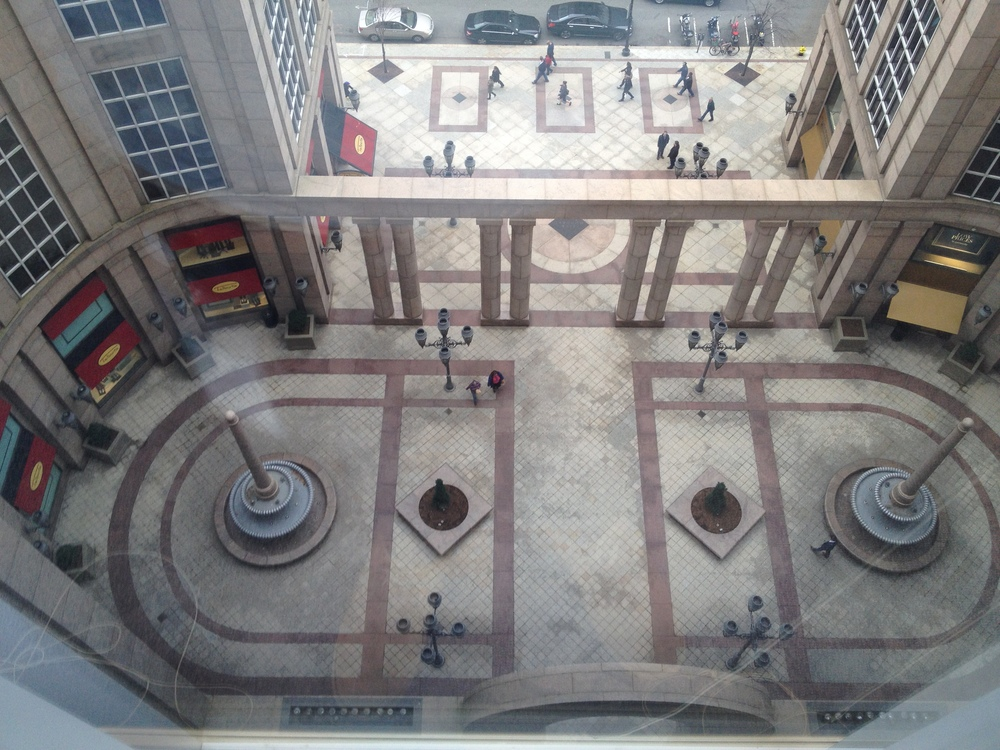 500 Boylston's plaza is a miniature abstraction of St. Peter's Square at the Vatican: oval in plan, enclosed by columned arches, with symmetrical fountains, each featuring an obelisk of sorts.
