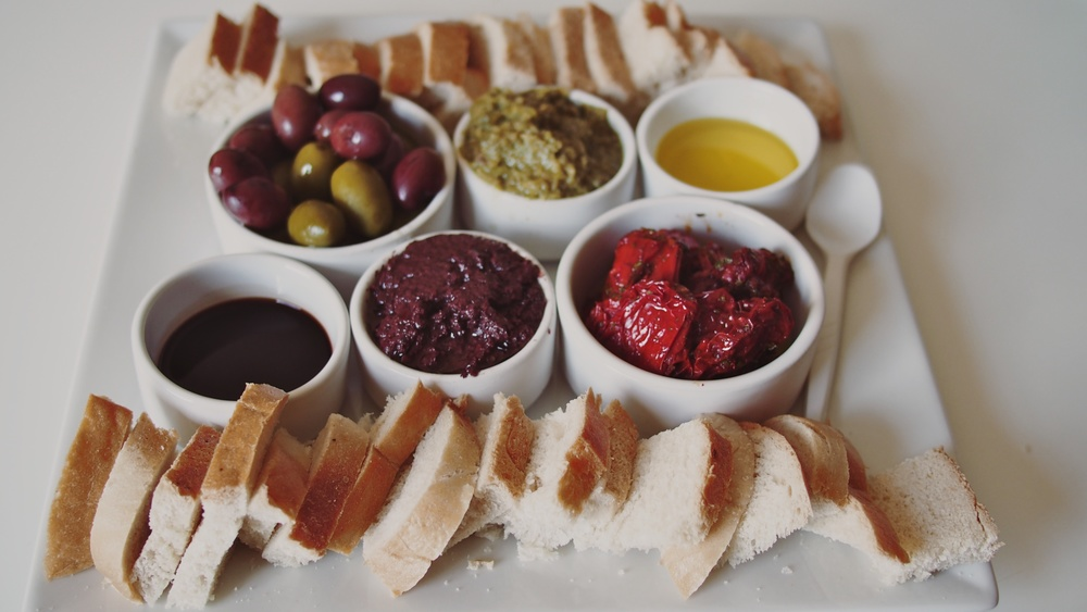 The tasting plate: bread, olive oil, balsamic vinegar, tapenades, olives and sun-dried tomatoes