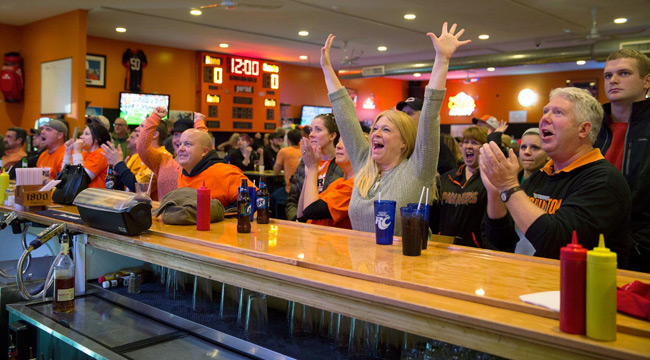 Brenda Hopkins and other fans watch the game at Kep's.