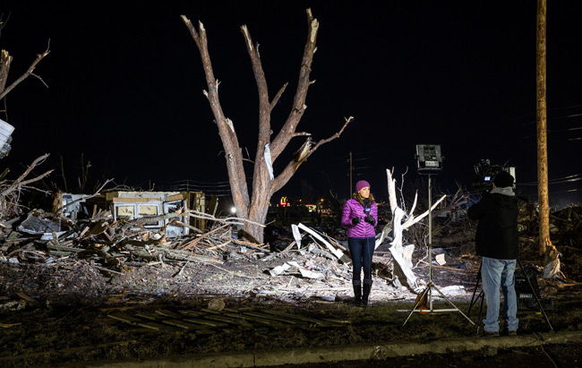 A reporter relays the destruction caused by the tornadoes.