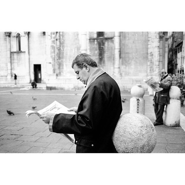 A man reads his morning paper in Cathedral of San Martino Square, Lucca, Tuscany. This photograph is part of my street photography collection at the North Hotel.