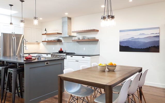 Floating Walnut shelves, Soapstone countertops, site finished Walnut floors and art from a local photographer on the wall are just a few of our favorite details from this San Francisco project.