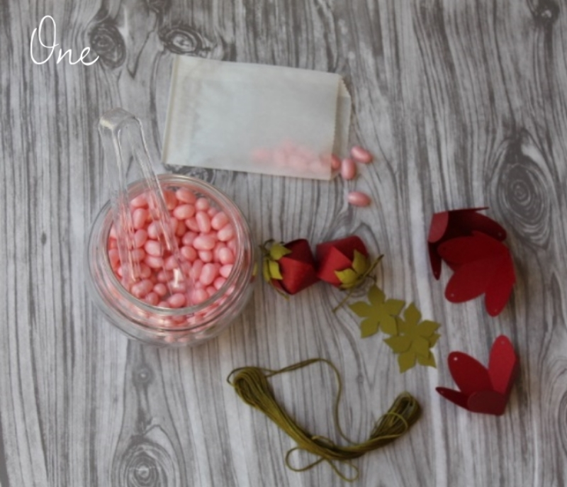 Gather your supplies, pre-cut Strawberry Boxes by  Lori Whitlock  , Candy, Thread, Glassine Bags and Scissors. Step by Step DIY photo by maritza Garcia