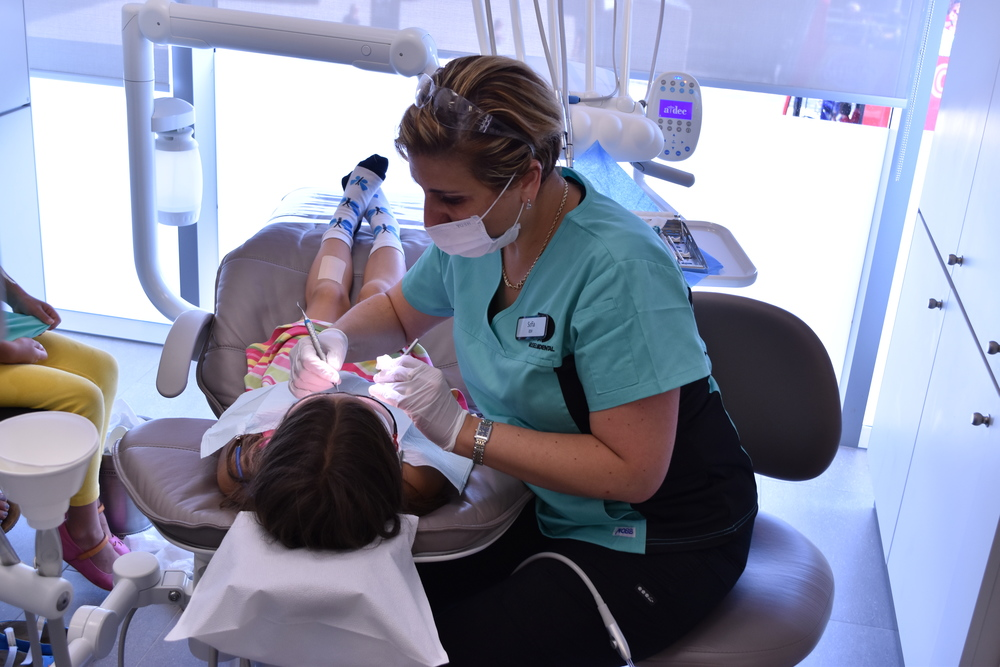 Our registered hygienist Sofia with a very brave young patient!