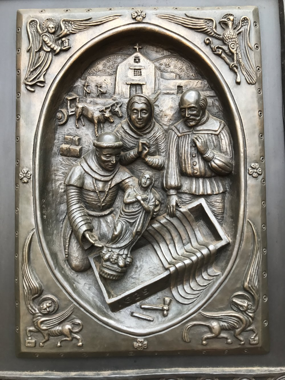 one of the images on the front doors of the church
