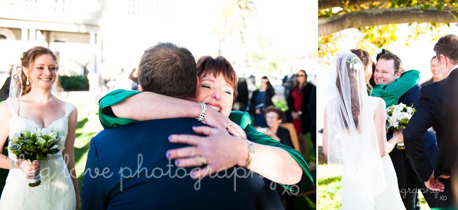 brides mother hugging groom