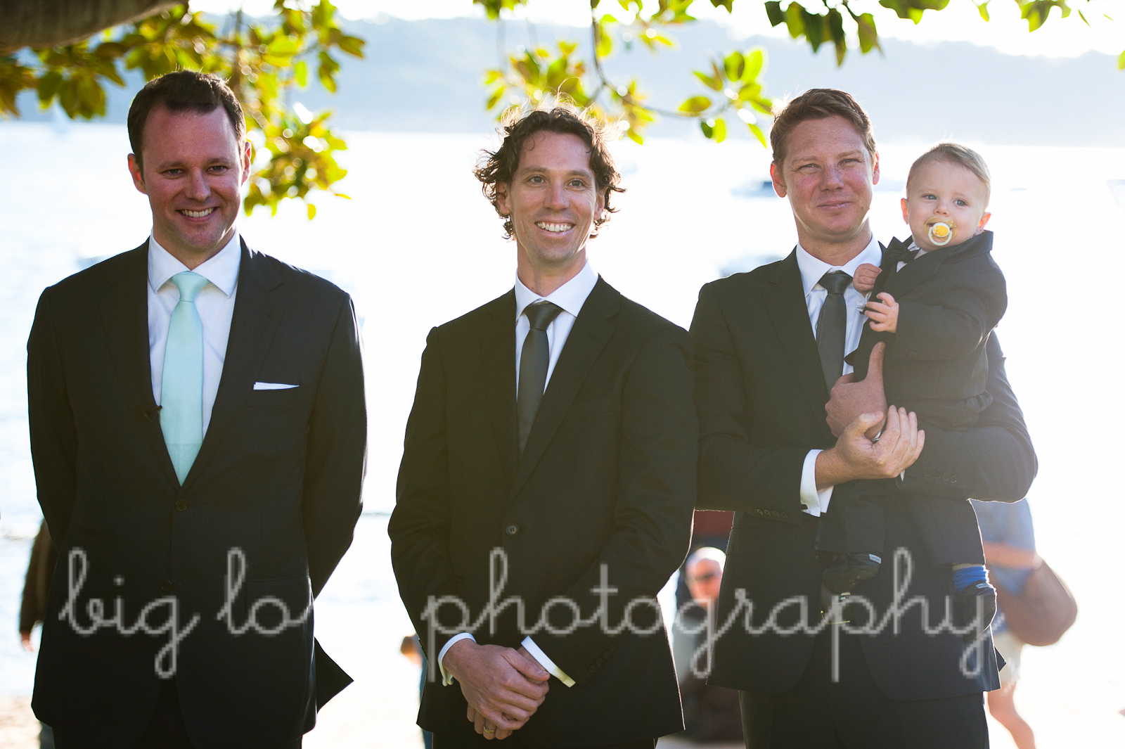 groom, with groomsmen and child