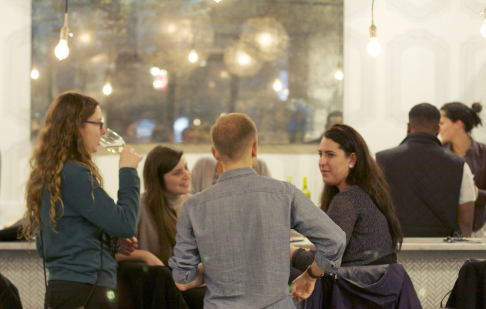 Tutors gathered at the WeWork Bryant Park bar with Director of Communication Daniel Penny.