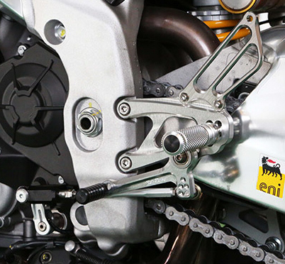 Sato Racing Rearsets for RSV4 -Standard Shift: Shift and brake pedals feature double stainless bearings for smooth, precise pedal operation. Deeply knurled footpegs provide optimal grip even in wet conditions. Choose from 5 adjustable positions in a range that puts your feet higher and further back compared to stock.