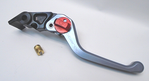 Oberon Adjustable Brake Lever Ti/Red Adjuster: This completely proprietarily designed brake lever features a totally unique design that has 8 adjust on the fly positions, and adjustable brake switch trigger, and, most importantly a specially located adjuster pivot so that complete lever stroke is retained no matter which of the positions is selected.