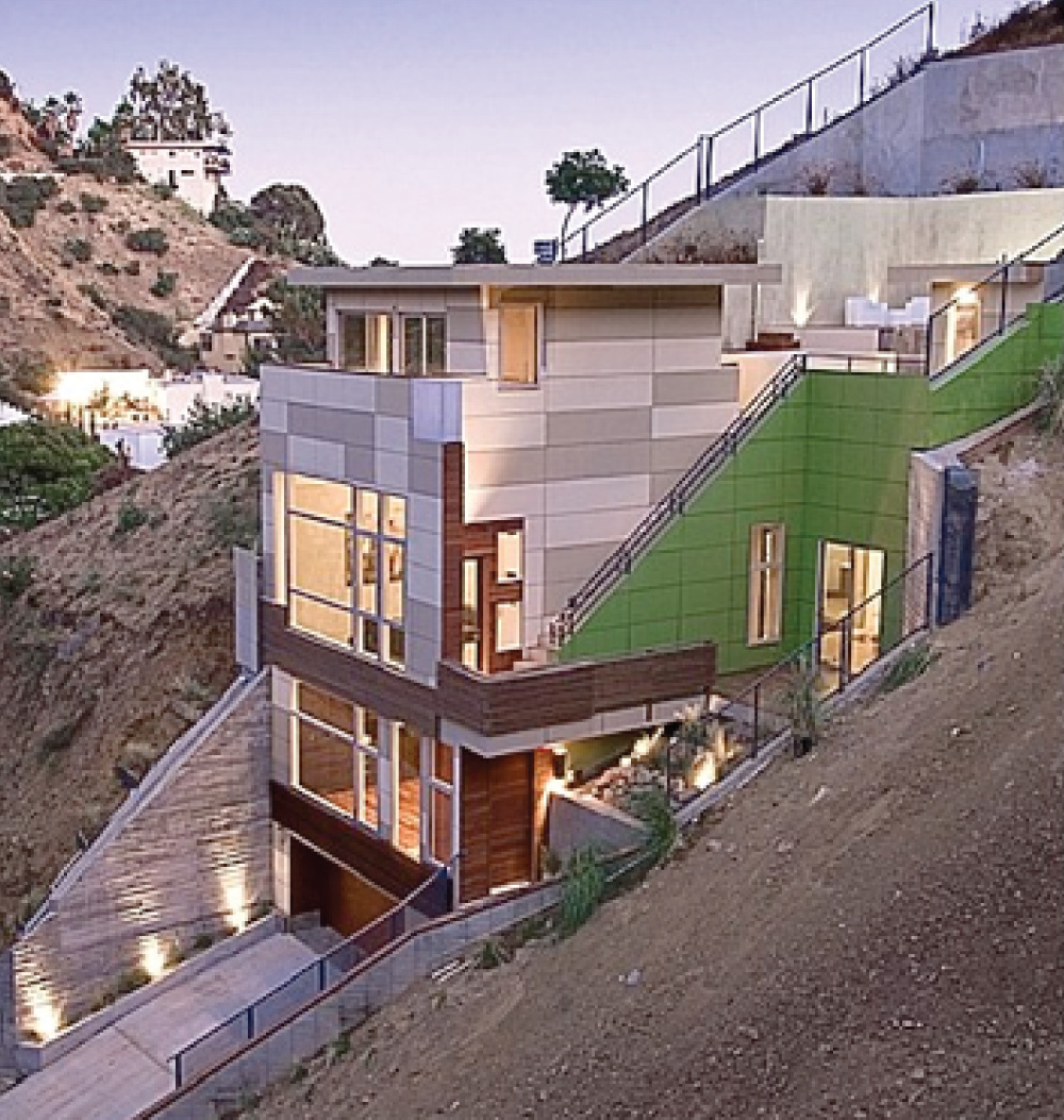 This Modern architectural residence completed in 2008 is located a quiet canyon called the Hollywood Dell in the Hollywood Hills.   It joins a few other modern homes in the neighborhood, including a hilltop residence designed by Pierre Koenig.  Wickham's residential project is a glamorous home where space, light, and clean lines come together to create a feeling of tranquility and high style.  Wickham's three level house design in the Hollywood Hills includes a penthouse studio and roof deck pool.