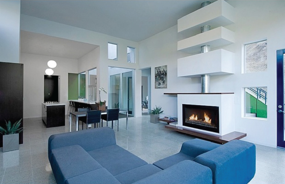 The main living area is graced by a Donald Judd inspired fireplace.