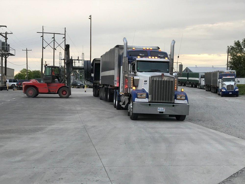 3 Trucks Unloading.JPG