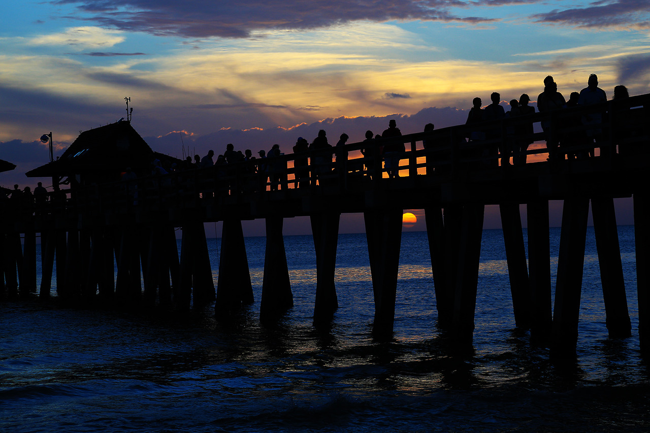 Sunset under the Naples Pier. I was pretty surprised at the number of people at the beach for August.