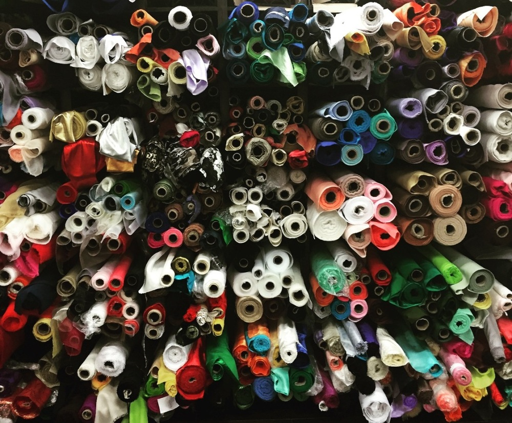 Stack of fabrics at Jack B on 4th Street Fabric Row in Philadelphia photo by Doreen Creede