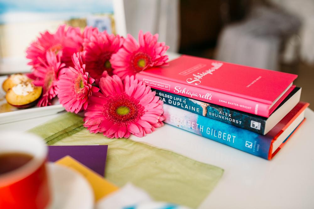 fresh flowers stacks of books