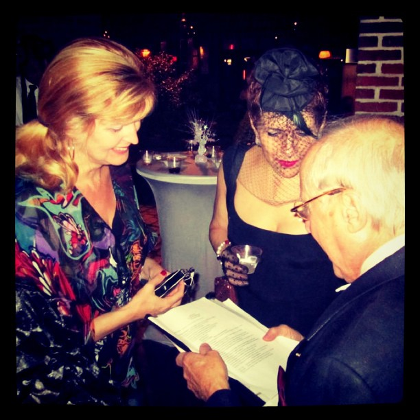 "Doreen Creede / Style Maniac and artist Denise Fike congratulate Emil DeJohn on receiving the City of Philadelphia' ""Crystal Award of Excellence"" in 2011."