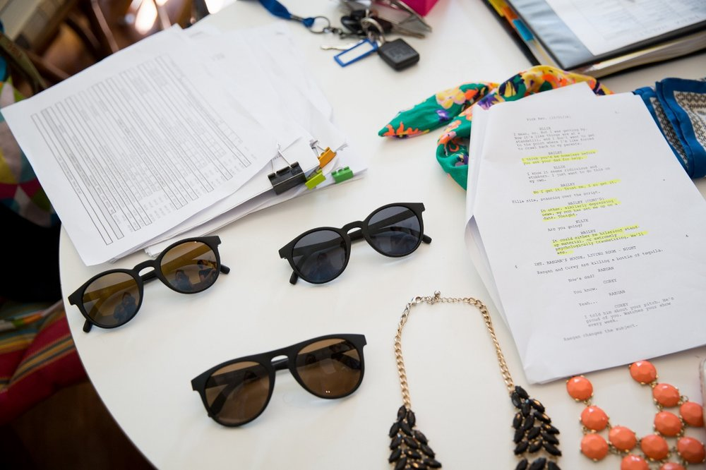 ON SET: Scripts and sunglasses from wardrobe brand partner SUNSKI.