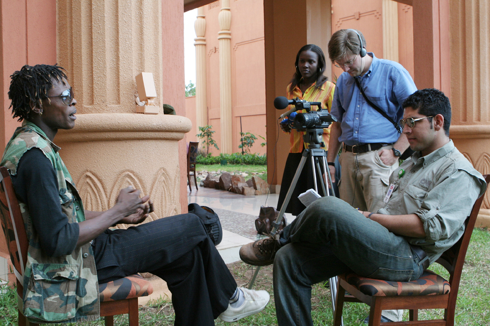 Interviewing rapper Chameleon with CNN's Nick Valencia in Kampala Uganda, 2006