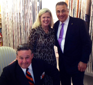 Steven Stolman, president of Scalamandré (seated), Patricia McLean and Louis Renzo, owner of Scalamandré, celebrate the release of the new book.