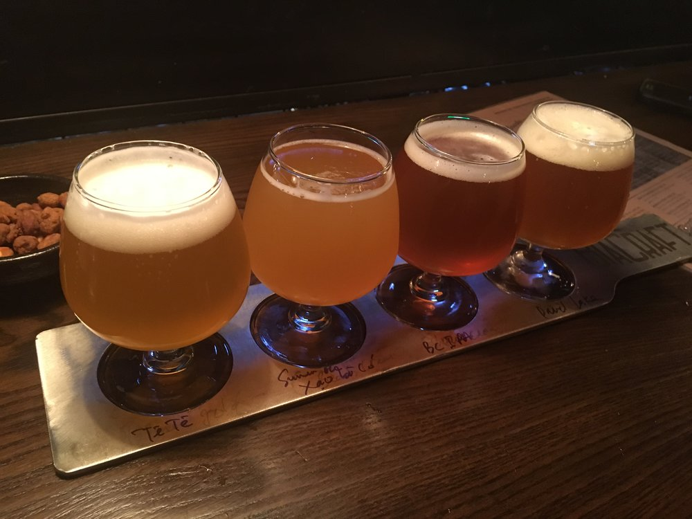 Our first tasting flight: Tê Tê Belgian Wheat, BiaCraft's Xao Ba Co India Summer Ale, BiaCraft's Xau Ma Chanh IPA, Lac Brewing Co.'s Devil's Lake IPA