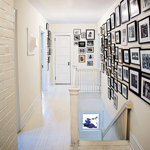 prettyspace: white hallway with lots of frames (by doorsixteen) I reckon I could do with some frames on my walls.