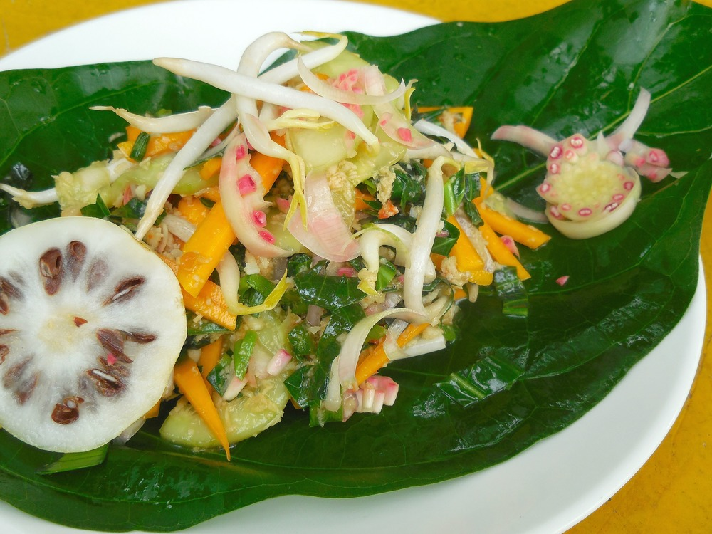 Mengkudu Salad, a raw Ulam of young Noni shoots, pumkin, cucumber , onions , fresh coconut shreds , marinated in a lime and Torch Ginger dressing.