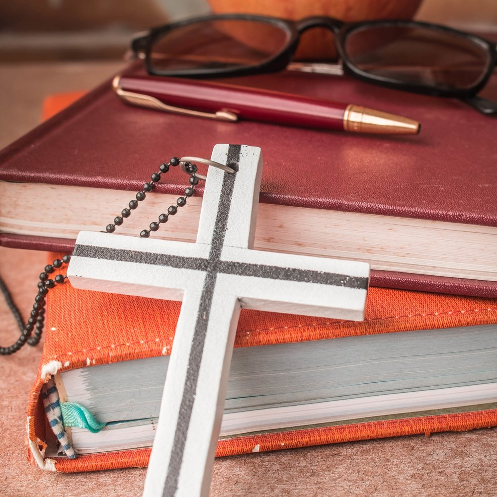 the-cross-against-the-book-PRYYR4D.jpg