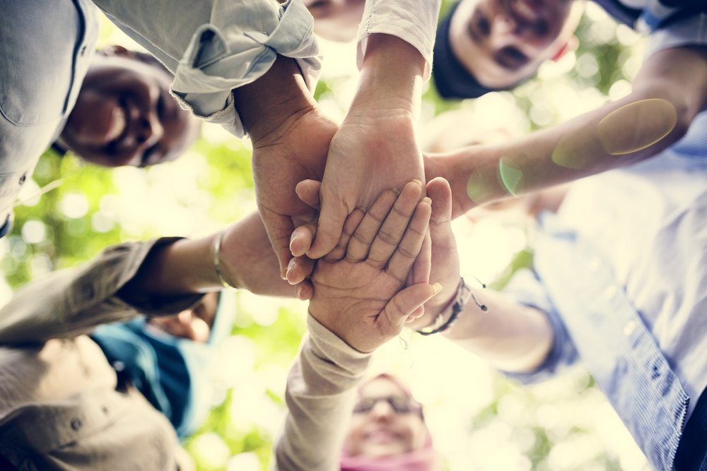 group-of-diverse-youth-hands-joined-P32XKA8.jpg