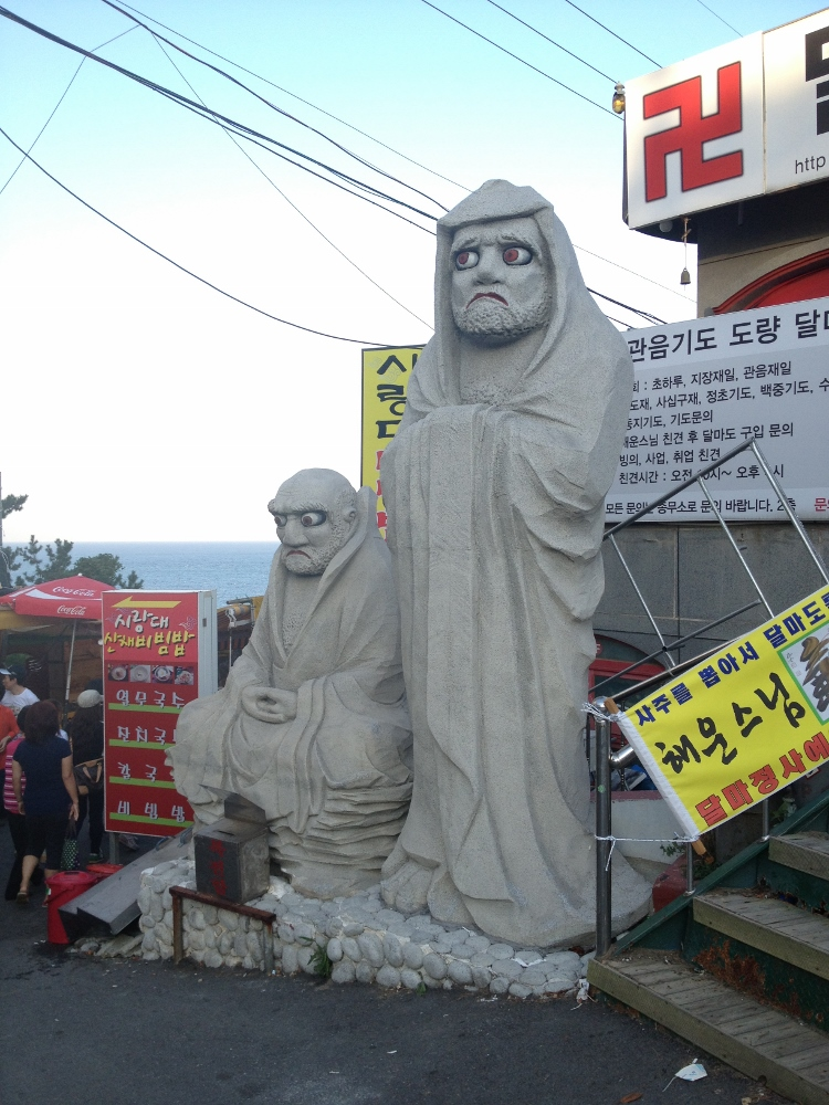 Seriously worried looking statues