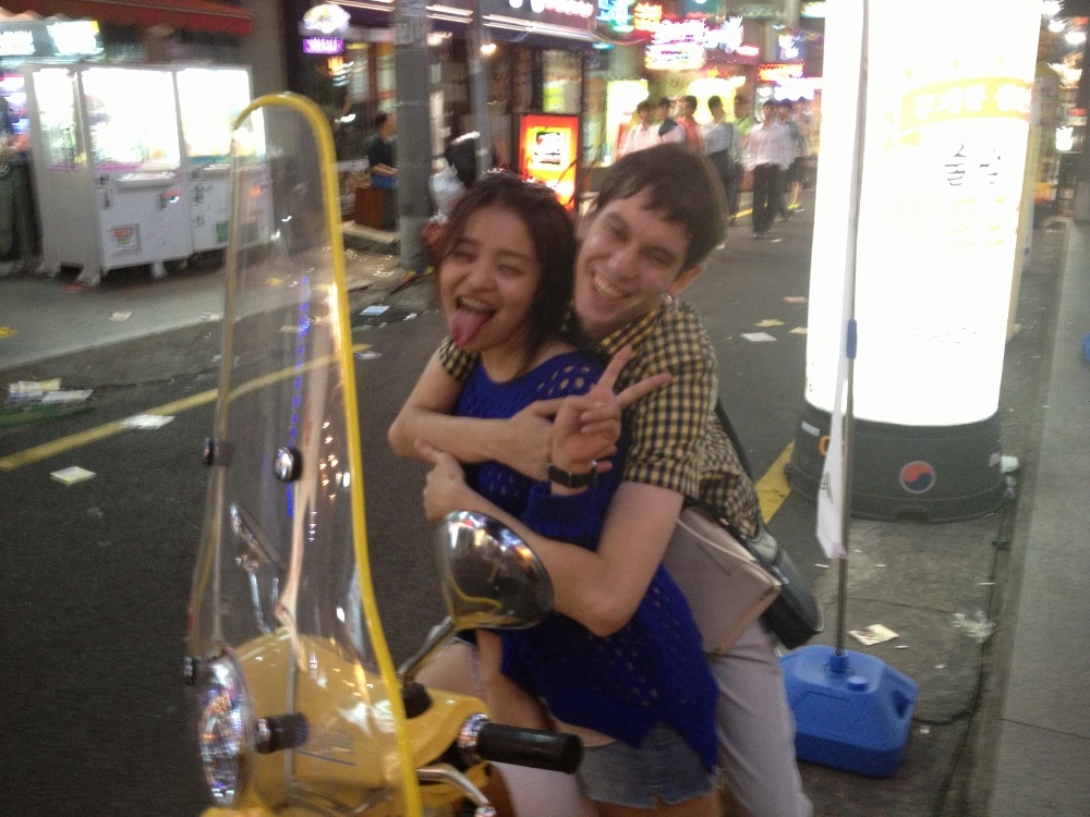 April and Chase on some random bike outside Thursday Party
