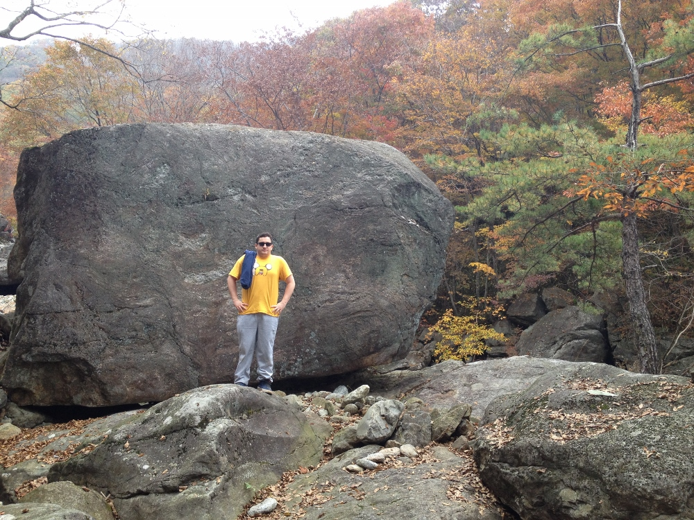 Me and a giant rock amidst the scenery (still looking fairly complacent at this point)