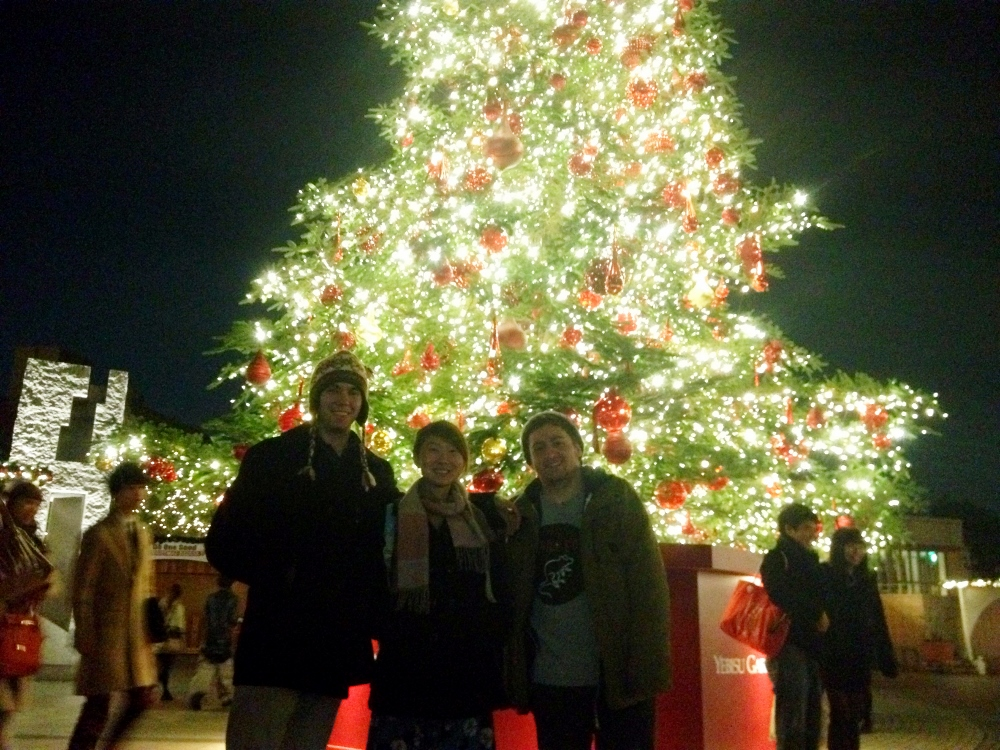 Chase, Deboarah and Me in front of a giant christmas tree at Ebisu Gargen