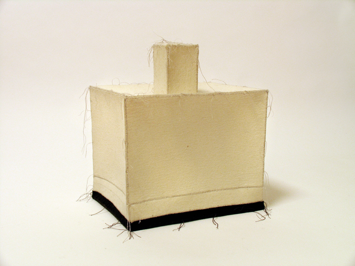 "Enclosure , 2007. Industrial wool felt hand stitched with silk thread. 12.75"" x 8.5"" x 8"""