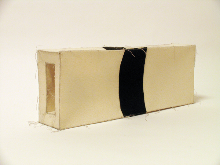 "Passage , 2008. Industrial wool felt hand stitched with silk thread. 8"" x 21"" x 4"""