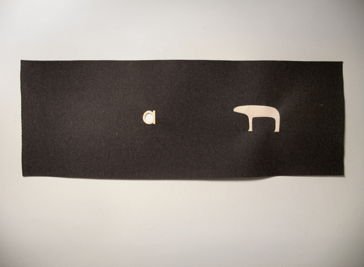 "a bear , 2009. Industrial wool felt hand stitched with silk thread. 27"" x 76.5"""